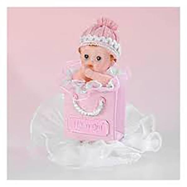 Sujet rose bébé dans sac à main