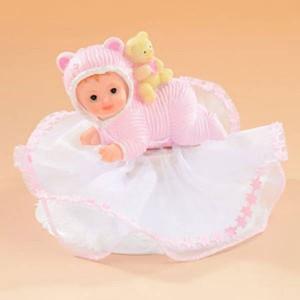 Sujet bébé rose sur le ventre