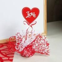 Coeur rouge sur pic